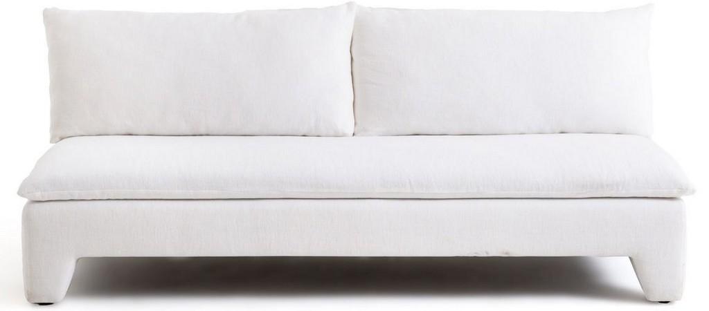 Un salon avec un canapé blanc - Joli Place